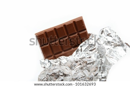 Chocolate bar in foil isolated on white background - stock photo