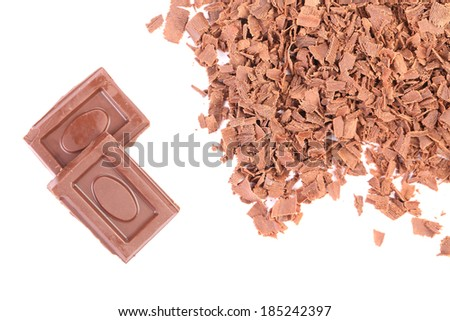 Chocolate bars and shavings. Isolated on a white background. - stock photo