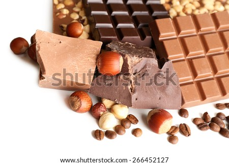 Chocolate bars with hazelnuts and coffee beans isolated on white - stock photo