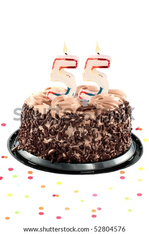 Chocolate birthday cake surrounded by confetti with lit candle for a fifty fifth birthday or anniversary celebration - stock photo