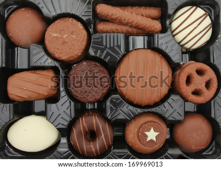 Chocolate biscuits in a plastic tray - stock photo