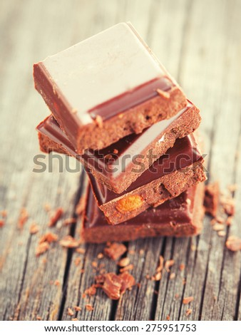 Chocolate blocks on wood table close-up - stock photo