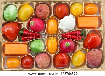 Chocolate box with vegetable and fruit contents - diet concept - stock photo