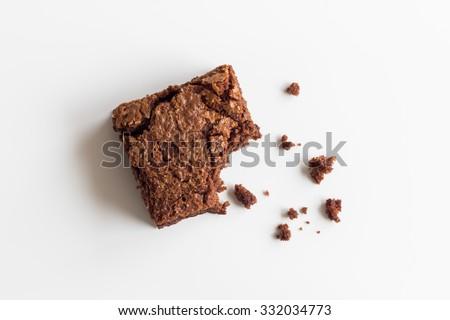 Chocolate brownie, bitten off - stock photo