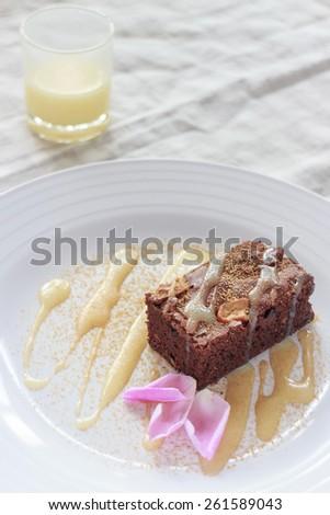 chocolate brownie with milk sauce - stock photo