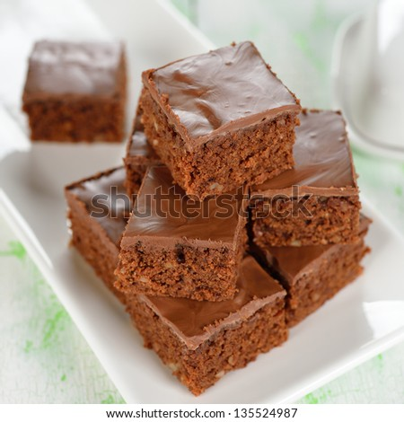 Chocolate brownies closeup on a white table - stock photo