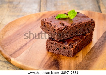 chocolate brownies on wooden board - stock photo