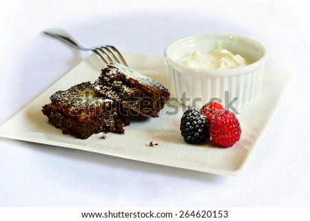 Chocolate brownies served on a square plate - stock photo