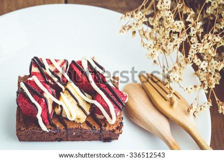 chocolate brownies & strawberry cheesecake - stock photo