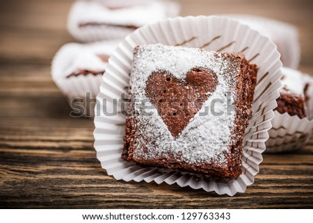 Chocolate brownies with heart shapes - stock photo