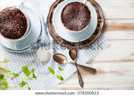 Chocolate cake in a coffee mug - stock photo
