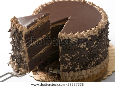 Chocolate cake in studio being sliced - stock photo