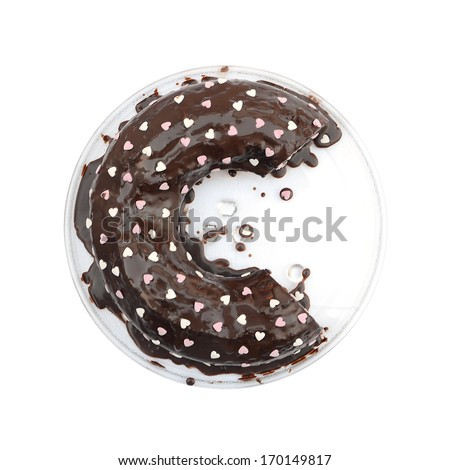 """chocolate cake in the shape of letter """"c"""" mimicking the logo of """"copyright"""" and decorated with white and pink hearts - stock photo"""