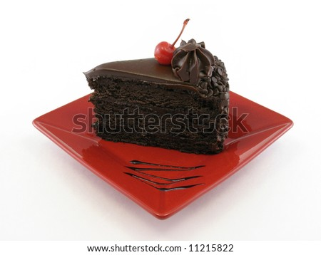 Chocolate cake on a red plate isolated on white - stock photo