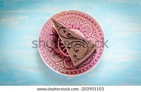 Chocolate cake on the purple plate - stock photo