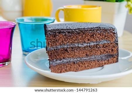 Chocolate cake on white dish - stock photo