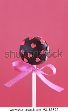Chocolate cake pop decorated with pink sugar hearts, selective focus - stock photo