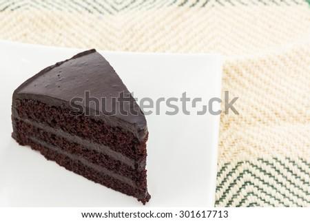 Chocolate cake slice on white plates. - stock photo