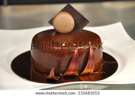 Chocolate Cake with a macaron - stock photo