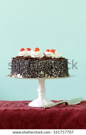 Chocolate cake with cherries and whipped cream (Black Forest) - stock photo