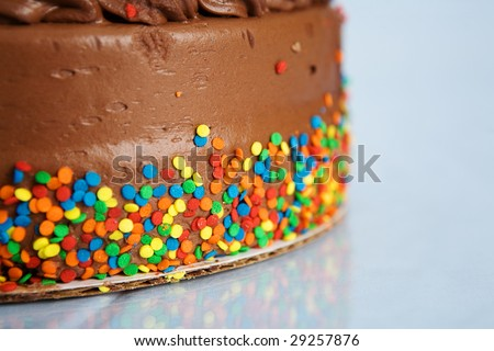 chocolate cake with confetti - stock photo