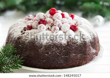 Chocolate cake with cranberries, new year, Christmas. - stock photo