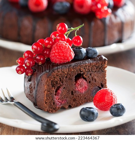 Chocolate cake with fresh berries, selective focus - stock photo