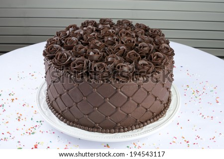 Chocolate Cake with handmade Chocolate frosting roses - stock photo