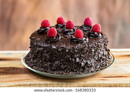 Chocolate cake with raspberries topping - stock photo