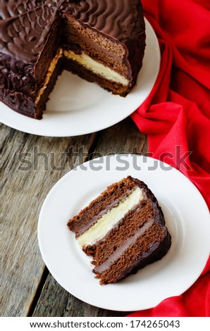 chocolate cake with red cloth on a wood background - stock photo