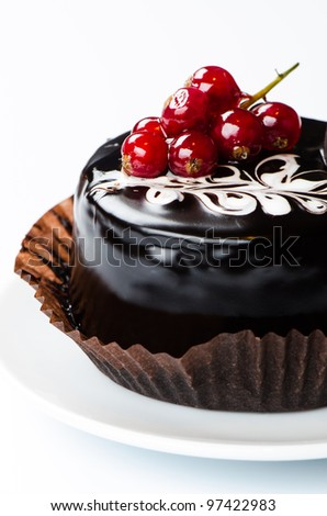 Chocolate cake with redcurrants on white - stock photo