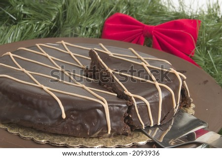 Chocolate cake with slice cut ready to serve for Christmas party - stock photo
