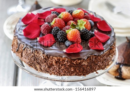 Chocolate cake with strawberries. Birthday party table, wooden background. Selective focus - stock photo