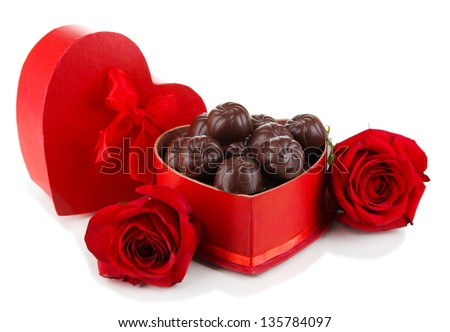 Chocolate candies in gift box, isolated on white - stock photo