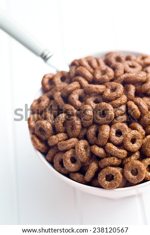 chocolate cereal rings in bowl - stock photo