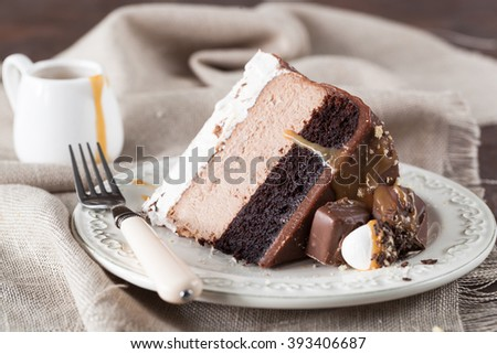 Chocolate Cheesecake with a layer of nougat and salted caramel - stock photo