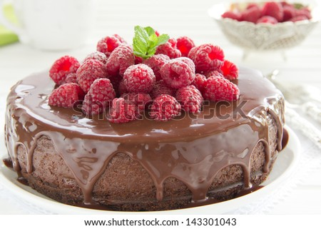 Chocolate cheesecake with raspberries. - stock photo
