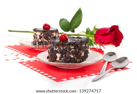 Chocolate cherry cakes and red rose in Valentine's day isolated on white - stock photo