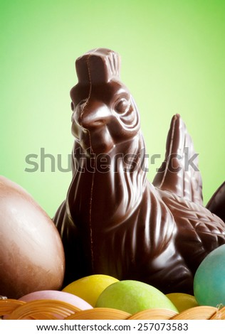 chocolate chick with easter eggs - stock photo