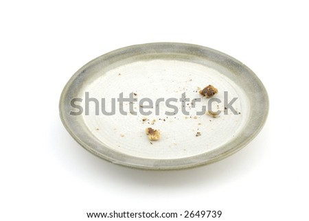 Chocolate chip cookie crumbs on a pottery plate. - stock photo