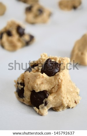 Chocolate Chip cookie dough ball on parchment paper - stock photo