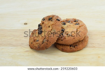 Chocolate chip cookie on cutting board - stock photo
