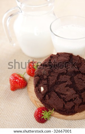 chocolate chip cookie with milk and strawberry, shallow DOF - stock photo
