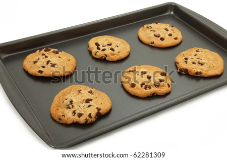 Chocolate Chip Cookies On Baking Sheet Isolated Over White Background - stock photo