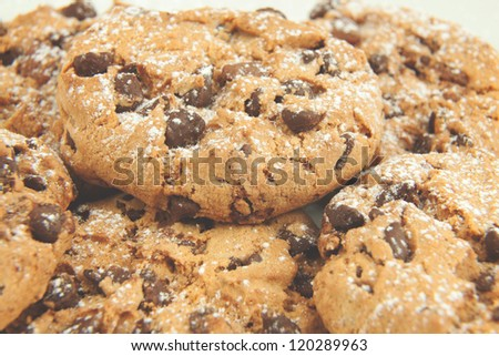 Chocolate chip cookies with fine sugar on top on a white background - stock photo