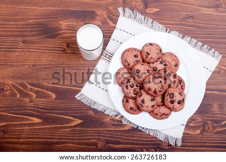 chocolate chip cookies with milk on  board top view - stock photo
