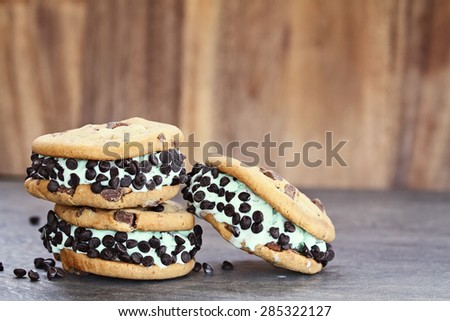 Chocolate chip mint ice cream cookie sandwiches. Extreme shallow depth of field with selective on cookies. - stock photo