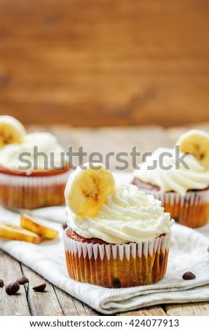 chocolate chips banana cupcakes. toning. selective focus - stock photo