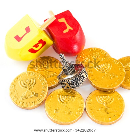 Chocolate coins and dreidels for Hanuka celebration. - stock photo
