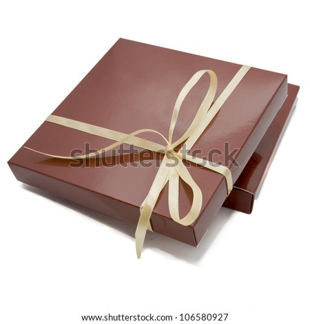 chocolate color box for candy, tied beige ribbon. Sweet gift or surprise for your favorite. Ready for your logo, text or symbol. Isolated on white background with clipping path - stock photo